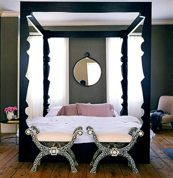 A black metal frame bed, beautifully paired with the inlaid mother-of pearl  stools